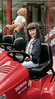 Five-year-old Mia Kilgallen, granddaughter of lucky winner William Smyth from Cahir, Co Tipperary at Honda in the M50 Business Park, Ballymount in Dublin