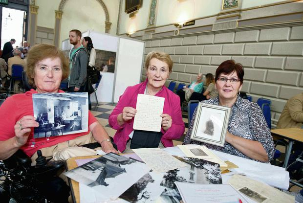 Pictured are (LtoR) Anne Richards, Carmel Shanahan and Rita Gallagher with photographs and letters from Peter Leo McGrane at the World War 1 Roadshow hosted by Trinity College Dublin in partnership with Radio 1 and the National Library of Ireland. Photo: El Keegan