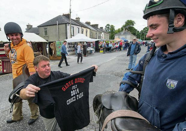 Street trader William O'Connor tempts visitors to the fair with his bargain Garth Brooks T-shirts. Michael Mac Sweeney