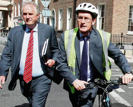 Owen Keegan (with bike) and Jim Keogan, both of Dublin City Council.