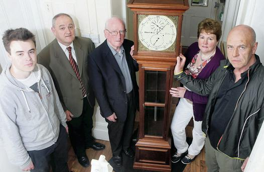 Michael O'Hora, County Librarian Donal Tinney, Vincent O'Hora, Angela McGurrin, Sligo Library, and Noel O'Hora with the clock