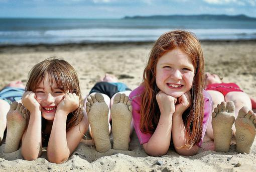 Michaela Dunne and Adah Stack enjoying the sunshine at Donabate beach yesterday.