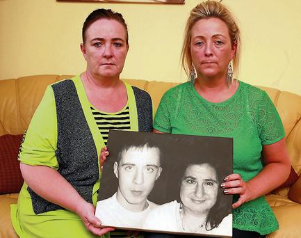 Deborah and Donna Lambe with a picture of their sister Linda and her son Danny Talbot. Arthur Carron