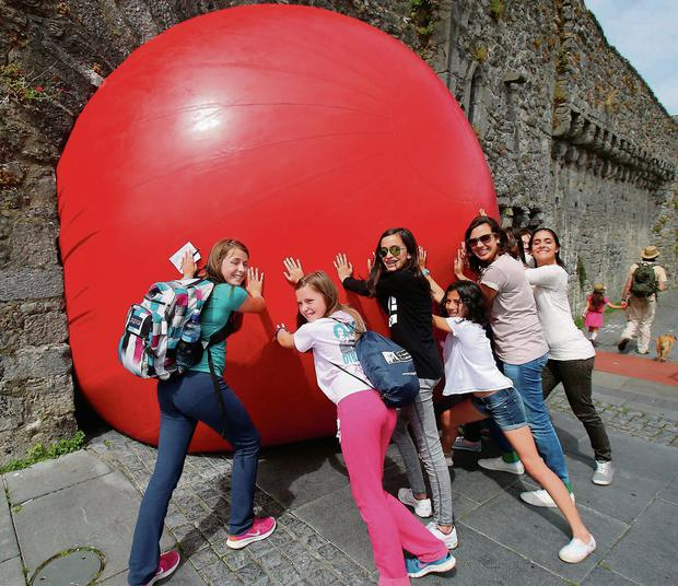 Joint Redball by US artist Kurt Perschke's adopted Galway as its canvas to block the Spanish Arch for the day, it was lots of fun for tourist and children as part of Galway International Art Festival.