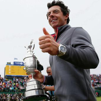 Rory McIlroy gives a thumbs up to the crowd after his two-stroke victory at The 143rd Open Championship at Royal Liverpool on July 20, 2014 in Hoylake, England. (Photo by Tom Pennington/Getty Images)