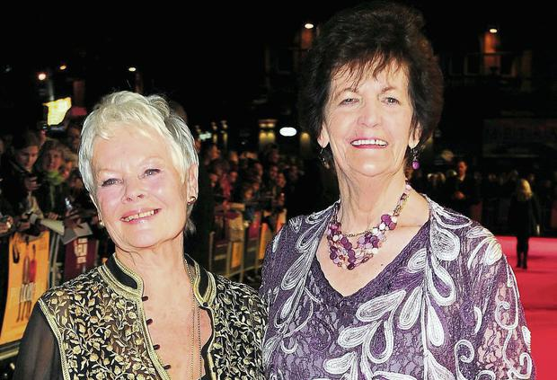 Dame Judi Dench and Philomena Lee attend a screening of 'Philomena' at the Odeon Cinema in London in October 2013.