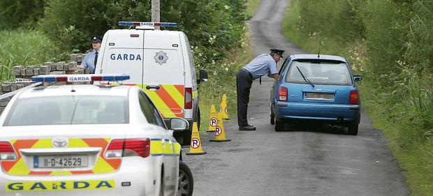 A garda checkpoint near the scene of the double tragedy in Banada, near Tubbercurry, Co Sligo, yesterday. Kyran O'Brien
