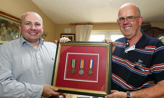 Larry O'Hara, left, from Waterford with his World War 1 medals that were returned to him by collector Gordon Power from Glenmore, Co Kilkenny. The medals were won by his late father Edward and stolen from his house.