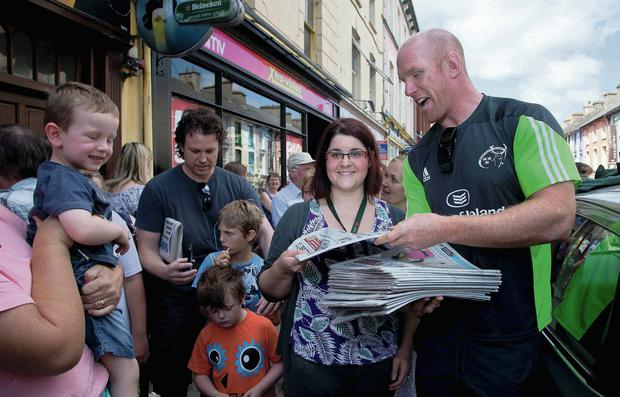 Paul O'Connell sells copies of the 'Irish Independent' in Limeric