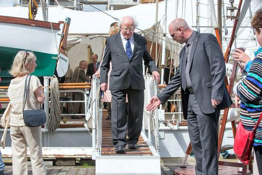 President Higgins leaving the tall ship