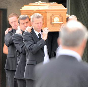 Colm The Gooch Cooper carries the coffin of his mother Maureen