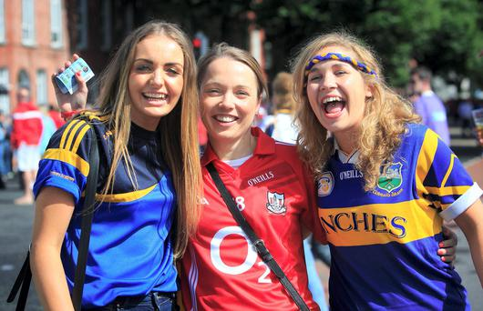 Tipperary fan Shauna Tooher, Cork fan Liz Power and Tipperary fan Mary Ryan at the All Ireland Hurling Semi Final between Cork and Tipperary at Croke Park, Dublin. Photo: Gareth Chaney Collins
