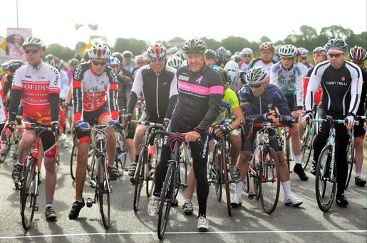 Stephen Roche and fellow cyclists start the Loop of Leinster charity cycle from St Laurence's GAA club, Narraghmore, Co Kildare