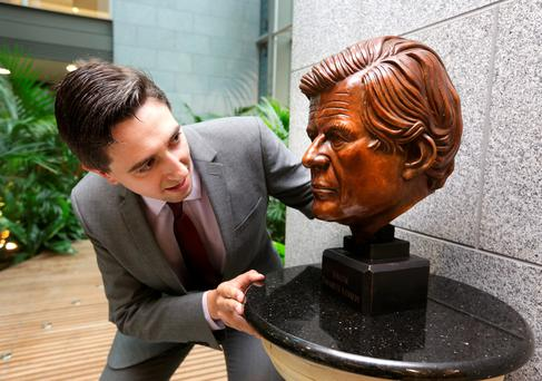 Simon Harris, TD, Minister of State admires a bronze bust, of Senator, Edward M Kennedy at the presentation to the Edward M Kennedy Institute for Conflict Intervention at NUI Maynooth with a bronze representation of the Senator. Photo; Damien Eagers.