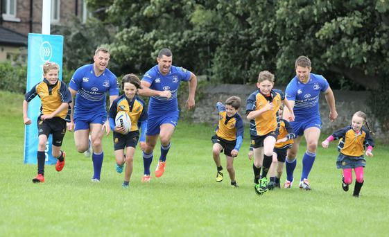 Leinster players, Rob Kearney, Sean O'Brien and Jamie Heaslip, run after kids from Clondalkin Rugby Club in Dublin yesterday. Photo: Damien Eagers
