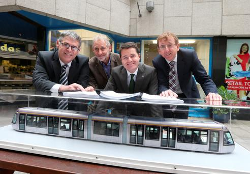 Acting chief executive of the Railway Procurement Agency Rory O'Connor, chief executive of the National Transport Authority, Gerry Murphy, Transport Minister Paschal Donohoe and Brian Brennan, managing director of Transdev Dublin Light Rail Limited at the signing of the operating contract yesterday. Photo: Damien Eagers.