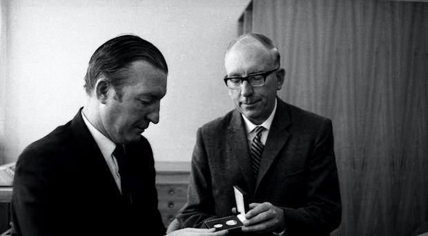 The then finance minister Charles Haughey is formally presented with the first of Ireland's new decimal coins by Dr TK Whitaker, who was governor of the Central Bank, in September 1969. Picture: Irish Photo Archive.