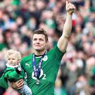 Brian O'Driscoll carries his daughter Sadie at the end of the match