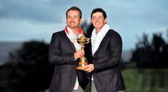 Graeme McDowell and Rory McIlroy celebrate with the Ryder Cup.