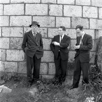 Poet Patrick Kavanagh with writers John Ryan and Anthony Cronin at Sandymount Strand on Bloomsday, 1954.