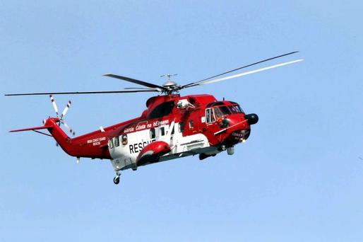 The Coast Guard helicopter