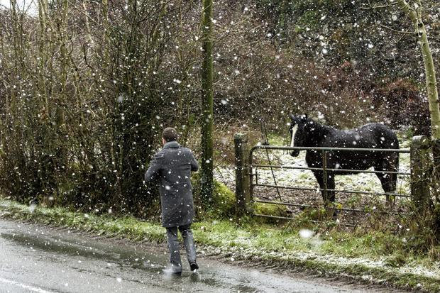 Snow blankets parts of United Kingdom as temperatures plunge to -7C