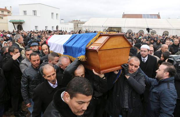 People carry the coffin of slain police officer Ahmed Merabet after a funeral service at the Bobigny Mosque, east of Paris, France yesterday. Photo: AP