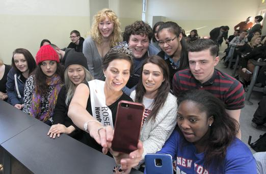 Rose of Tralee Maria Walsh shares a selfie with students at Griffith College, Dublin. Photo: Gareth Chaney Collins
