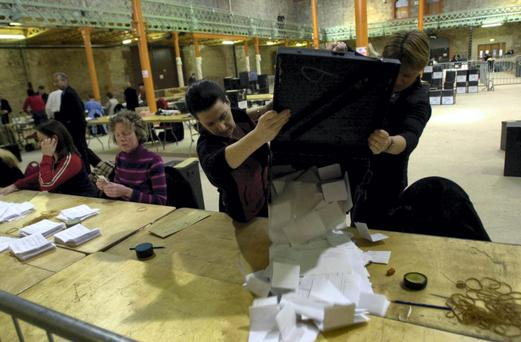 A tide of votes: Ballot papers are delivered for counting in the 2002 amendment