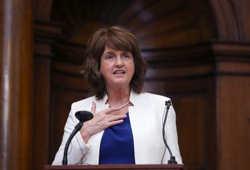 Joan Burton was left walking a political tightrope. On the one hand she needed to assert Labour's individual position. On the other, there is the little matter of keeping the Coalition on track