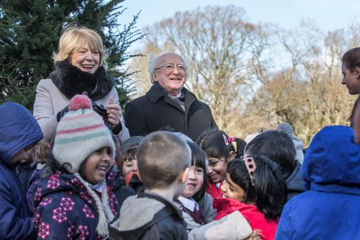 President Michael D. Higgins and his wife, Sabina who planted their official trees on the main avenue of Áras an Uachtaráin with the help of Junior Infants children from St. Peter's National School in Phibsboro. Photo: Mark Condren