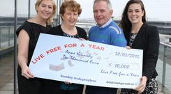 Anne and Gerry Kennedy, from Limerick, are presented with a cheque for €10,000 by Arlene Regan, left, marketing manager of the Irish Independent, and Brighid Carson, marketing manager, Sunday Independent