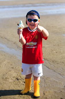 Caelum Singleton (3), from Tallaght, enjoying the good weather on Portmarnock Beach, Dublin