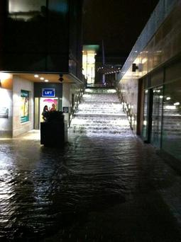 Water cascades down a stairwell at Dundrum Town Centre in 2011