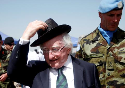 President Michael D Higgins dons his hat during a visit to the Irish peacekeepers of the United Nations Interim Force in Lebanon (UNIFIL) in Tiri village, southern Lebanon