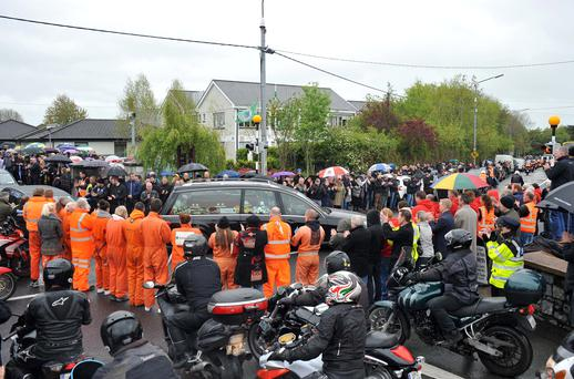 Colleagues from Down Syndrome Ireland and motorcyclists line the streets in Lucan, Co Dublin, as the remains of Aidan Lynam were brought to the church