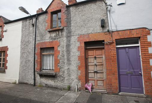 Flowers left outside Hilary Conway's home at St Malpas Place, Clanbrassil Street, Dublin