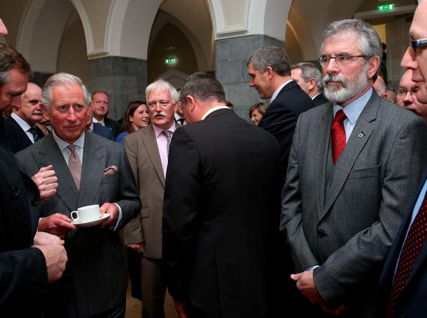 Gerry Adams waiting to speak with Prince Charles at NUIG yesterday