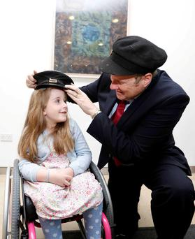 Ivan Yates with seven-year-old Emily Fitzsimons from Naas