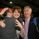CELEBRATIONS: TD John Lyons, left, with Tanaiste Joan Burton and Kevin Humphreys at the count in the RDS in Dublin