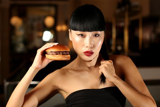 Yomiko Chen pictured in Beeftro reatuarant with one of the Kobe style Beef Burgers