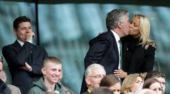 FAI chief executive John Delaney kisses his partner Emma English while Sports Minister Paschal Donohoe watches the match between Ireland and England at the Aviva Stadium yesterday
