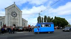 THE VAN: The funeral cortege of Alan Harris arrives at St Agnes Church in Crumlin, followed by Alan's converted Dubs van