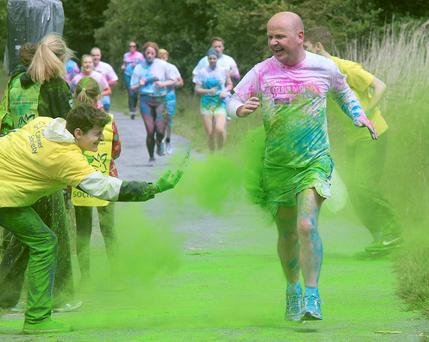 Tom Donoghue, of Sea Road, Galway, taking part in the Irish Cancer Society's first 'Colour Dash' in Galway yesterday