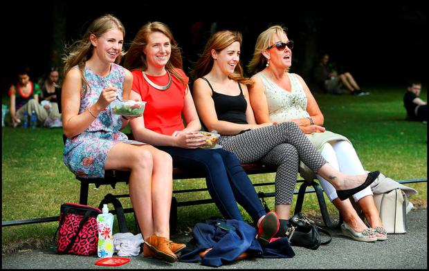 Tara Ní Reachtagáin, from Roscrea, Co Tipperary, Ciara Corkery from Nenagh, Co Tipperary, Dawn Armstrong from Dunboyne, Co Meath, and Dee O'Reilly from Castleknock, Dublin, enjoying the sunshine in St Stephens Green at lunchtime yesterday