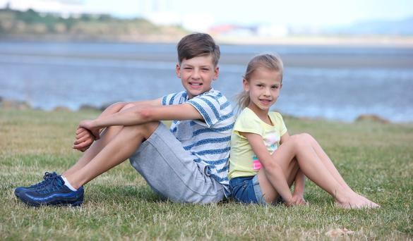 Danco Cojocov (13) with his sister Luiza (7) from Charlestown on Sandymount strand