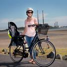 GETTING HER SPOKE IN: Sarah Caden, above, says she doesn't blame any motorist or pedestrian for regarding cyclists as a menace, because she herself is scared of some other cyclists