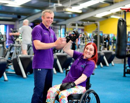 Nicola McDonnell takes part in the world's first wheelchair kettlebell class, with her instructor Kieran McDonell