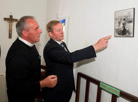 Taoiseach Enda Kenny with the OPW's Máirtín Ó Meachair at the official turning of the sod at Pearse's Cottage, originally built by Padraig Pearse