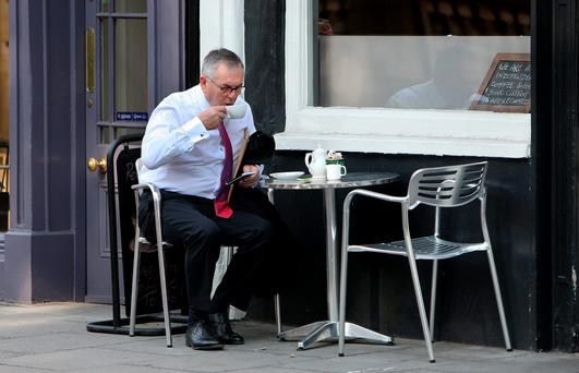 John McGuinness, chairman of the Public Accounts Committee, enjoys a break before the sitting yesterday